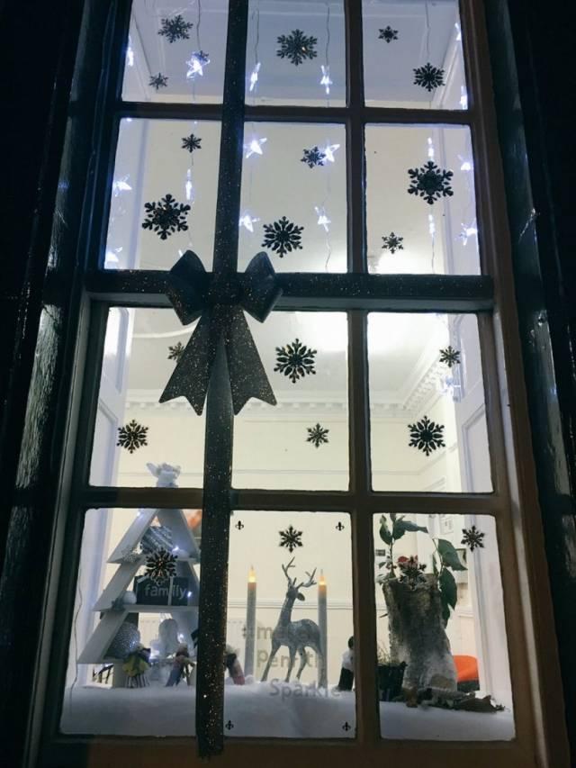 Sneak-peak Cartmell Shepherd Solicitors Window Display